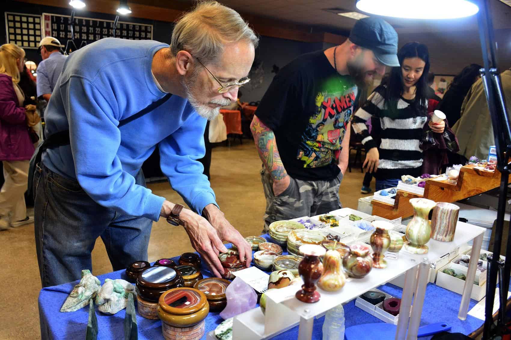 10/18/2014 Mike Orazzi | Staff John Hartshorn looks for items during the Bristol Gem & Mineral Club's 42nd Annual Gem & Mineral Show at the Bristol Senior Center on Saturday.